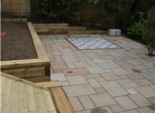 Indian sandstone, granite chess board, raised lawn, flower beds summer house