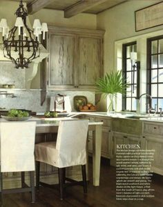 Pecky cypress cabinets in a driftwood color. McAlpine Booth  Ferrier