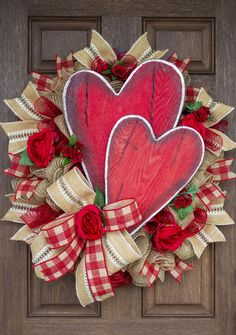 Burlap and hearts, oh my! Made on an oval evergreen, poly jute and red mesh are the base to the gorgeous burlap designer ribbons. The double hearts steal the show accented by red roses. What says love better than hearts and roses? Valentine Day Wreaths, Valentines Day Decorations, Valentine Day Crafts, Holiday Wreaths, Valentine Ideas, Holiday Burlap Wreath, Rustic Wreaths, Valentine Flowers, Valentine Tree