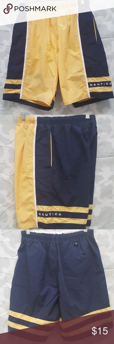 Vintage classic Nautica colorblock swim shorts For sale is a Mens Nautica  Swim Short  MEN'S SIZE: SMALL. SHELL: 70% COTTON 30% NYLON LINING: 100% POLYESTER  COLOR: Yellow, Blue, White.  GOOD USED CONDITION. Minor wear from wash/storage. May have if any little to no flaws. Knee length. Has two side pockets and also has small inner pocket No trades. Bundle to save on shipping!  REASONABLE Offers are welcomed through offer button only. NO LOWBALLING PLEASE. Nautica Swim
