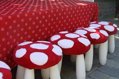 Toadstool stools, made with Ikea stools and minky fabric.  Perfect for a woodland fairy themed party.