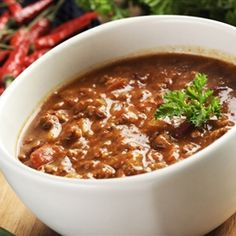 This chili with beans and meat recipe is a favorite in our house, and can be seasoned to taste to create a mildly flavored dish or one that is extra hot for those who enjoy some additional spice. As is, this chili is not too spicy but has just enough kick and the ingredients that go into it, give it teriffic depth of flavor.  - Beef Chili with Beans