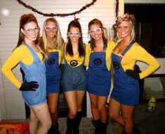 DIY Minion costumes from Despicable Me. Yellow t-shirt, overalls/suspenders, yellow baseball cap/headband, silver glasses, black gloves, black shoes.