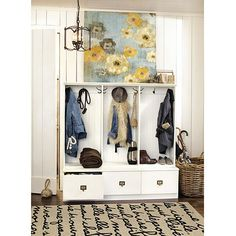 Love this entry... right down to the rug! Triple Beadboard Entry Cabinet by Ballard Designs