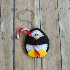 Felt Penguin Holding Candy Cane Christmas Ornament by PaisleyMoose More