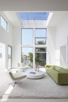 This narrow space is #designed to look more open and wide with the use of tall ceilings and lots of windows, including a skylight.  #architecture #architecturalcomponents #homedecor #bathroom #kitchen #bedroom #stairs #fences #railings #gates #pickets #balusters #forgediron #stainlesssteel #steelcomponents #howto #homedesign #exteriordesign #landscaping #design #diy #doityourself #homedecorating #interiordesign #euroarchitecturalcomponents #euroeac #diyinspo #designinspo #homerenovation…