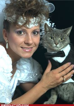 there are so many things to love about this picture.  the bangs, the dress, the cat in a suit...