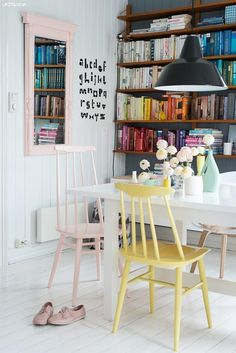 colourful home, interior, bookcase, white, dining room, mis matched chairs, pastel colours, kitchen