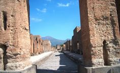 Vesuvius seen by way of narrow street of Pompeii. Where could anyone run to get away? Really brings home the feeling of no escape when you stand there.