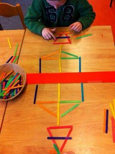 Let children use popsicle sticks to build with