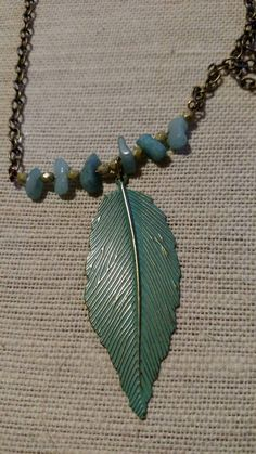 Check out this item in my Etsy shop https://www.etsy.com/listing/222808559/feather-antique-looking-necklace