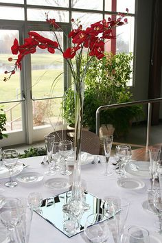 Centerpieces Using Eiffel Tower Vases   ... Eiffel tower vase set on a beveled edge mirror with 4 votive candles