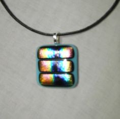 Blue dichroic fused glass necklace | dancinghorsestudio - Jewelry on ArtFire  $16 plus shipping  15% off is you spend $20 or more in my Artfire shop - use code XMAS15.