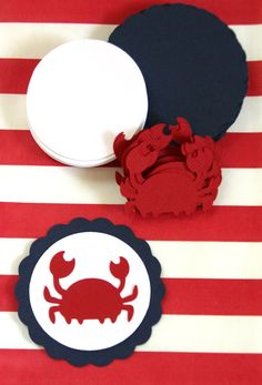 30 Die Cut Scallop Circle Nautical Crab DIY Cupcake Toppers (2.5 inches) in Navy, Red, & White Cardstock - Baby Shower, Birthday, etc.. $6.75, via Etsy.
