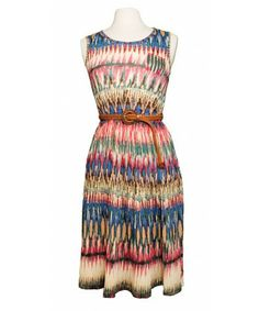 """The vibrant colors and the braided belt just speak """"summer""""! The dress has a cute little pocket on the left side and elasticated waist. Pleated at the bottom. Belt is included."""