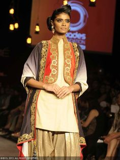 Vikram Phadnis | Lakme Fashion Week 2013 Patiala suit with jacket and cape. Exquisite embroidery details
