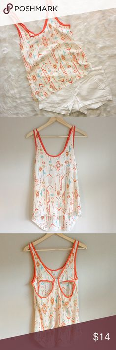 Bella D Hi-Low Chiffon Tank Top Small Gently used Bella D hi-low chiffon tank top. Size small. This top is so airy and comfortable! Perfect for summer. Beautiful cut out on back.                                                                         ❌ No Trades ❌ No off Poshmark transactions ❤️ Bundle and save 📬 Fast shipper ❤️ I love reasonable offers  Bella D Tops Tank Tops