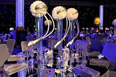 La Premier crafted spherical floral centerpieces to match the motif.