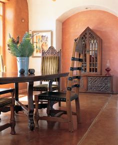 The room is furnished with an old Spanish-style dining set and curio cabinet, which is set into a recess in a lime-washed wall. The recess's interior was washed with lime colored with Venetian red and French yellow natural mineral ochres. Leather Sectional Sofas, Spanish Style Homes, Wall Colors, Paint Colors, Living Room Sets, Home Decor Accessories, Home Goods, House Design, Design Design