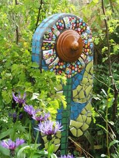 Interesting use of a ceramic lid in a mosaic sculpture