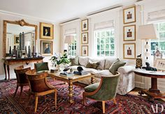 The family room of Corrigan's own Los Angeles home is furnished with a pair of vintage chairs by T. H. Robsjohn-Gibbings (left) and a second pair, in green, by André Arbus.