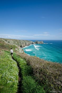 Porthcurno Beach, Cornwall, England - with the tide in! The Logan Rock in the background. As seen from the S. Places To Travel, Places To See, St Just, England And Scotland, London England, Oxford England, English Countryside, Adventure Is Out There, Great Britain