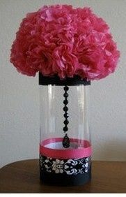 Pink paper poof in glass cylinder