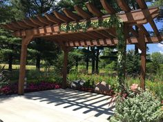 Loved it! Pinned it! A Blooming Envy Design! Pergola with greenery garland. Sentry World