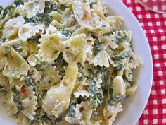 *I am in love with this recipe. Tastes just like the dip!!! Made several times. Dont skimp on the garlic. I add chicken & it's divine! Used multi grain bow tiesave made & is fabulous!* Spinach Artichoke Pasta