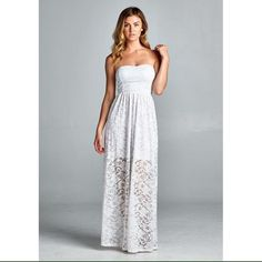 Strapless lace maxi dress with cut-out back detail Mini skirt inner lining. Bra cups included. Dresses Maxi
