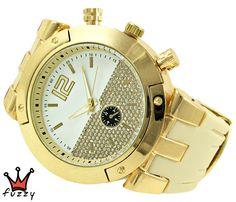 Γυναικείο ρολόι, με κάσα σε χρυσό  με ιδαίτερο εσωτερικό καντράν, στολισμένο με πολλά στρας.  Λουράκι σε εκρού χρώμα από σιλικόνη. Διάμετρος καντράν 48 mm