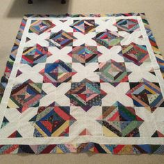 #46 of 2017 made by Sharon Theriault. Combination of 4 patch and snowballed blocks.