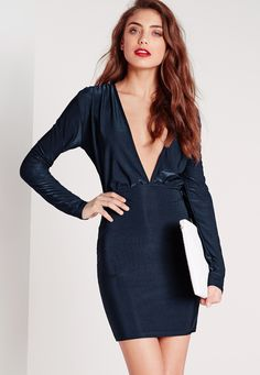 Holy smoke! If you're looking for the perfect dress for an evening then look no further. This dress has 'be mine' written all over it. In slinky long sleeves and a daring plunge neckline, you'll be turning those heads for all the right reas...