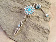 Hey, I found this really awesome Etsy listing at http://www.etsy.com/listing/130948940/turquoise-blue-dreamcatcher-belly-button