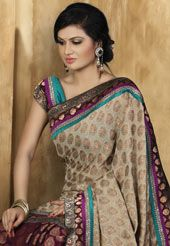 Item code: SRP50 - Deep Fawn Viscose Saree with Blouse - This deep fawn double dye viscose saree is beautifully embroidered with resham, sequins, self weaving, lace & patch patti work done in form of floral motif. Beautiful multicolour patch patti border is enhancing the beauty of this saree. Matching blouse is available with this saree. Slight variation in colour & patch patti pattern is possible. US$ 102.08. To shop now, click on…