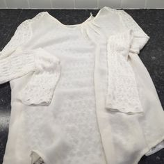 Zara Sheer/knit Top Stunning Zara top. Sheer front with knit lacing on back. Extra button still attached for back clasp ❤️❤️ Zara Tops Blouses
