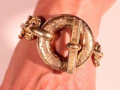CELINE PARIS 1988 Bracelet Gold Tone  Bracelet Articulated Bracelet Twisted Links Bracelet Extra Large Floral Clasp High Fashion Bracelet by ThisisParis on Etsy https://www.etsy.com/listing/241396448/celine-paris-1988-bracelet-gold-tone