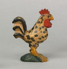 "Pook & Pook. 4/21/07.  Lot 574.  Estimated: $3K - $5K.  Realized Price: $22,230. Wilhelm Schimmel (1817-1890), Cumberland Valley, Pennsylvania, carved & polychrome decorated pine standing rooster with a yellow body highlighted with black, green & red on a small base, 4"" h. For similar examples, see the Collection of Helen Janssen Wetzel, Sotheby's October 1980, lots 1772-1776."
