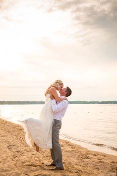 Groom lifts bride on beach during sunset #Michiganwedding #Chicagowedding #MikeStaffProductions #wedding #reception #weddingphotography #weddingdj #weddingvideography #wedding #photos #wedding #pictures #ideas #planning #DJ #photography #bride #groom