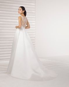 Romantic classic-style beaded lace and satin wedding dress. Its sensational beaded back will leave your guests speech