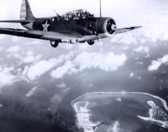 Wake Island Raid, 24 February Douglas Torpedo Bomber from USS Enterprise (CV files over Wake during the raid. Note fires on the island in the bottom center. Ww2 Aircraft, Aircraft Carrier, Military Aircraft, Navy Aircraft, Aircraft Photos, Uss Enterprise Cv 6, Wake Island, Douglas Aircraft, Naval History