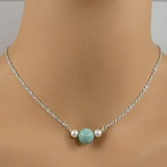 Necklace with two white pearls surrounding a turquoise stone on sterling silver chain.  BUY NOW http://jewelrybytali.com/products/turquoise-white-pearl-sterling-silver-chain-necklace