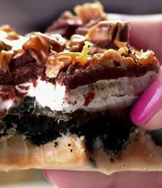 Recipe for Peanut Butter Pie Fudge - One of the best desserts ever! This pie has everything, Oreos, caramel, marshmallows, fudge, toffee and peanut butter fudge.. a decadent dessert recipe you'll want to show off at every party!