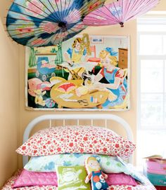 Antique paper parasols decorate the walls in this girl's room. The old iron bed frame is a $15 tag-sale steal, spiffed up with a fresh coat of paint. The linens are from eBay and Goodwill; the owner of this Maine home designed the frog pillow herself. A 1950s home-ec poster, scored at a vintage shop, hangs in the corner.