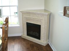 corner fireplace designs | Contemporary Corner Electric Faux Fireplace With Modern Design Also ...
