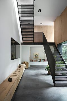 Photographer Peter Krasilnikoff commissioned Studio David Thulstrup for his private residence and studio in #Copenhagen. The guiding inspiration for the project evolved from worn-out warehouses and factories with their blackened steel and old bricks #staircase