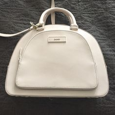 DKNY cream dome shaped crossbody bag Used a few times, few mild stains as shown in pic 3 and 4. 2 short and one long detachable handle. 4 inner side pockets. No stains on interior, has a front zipped compartment see pic 3 DKNY Bags Crossbody Bags