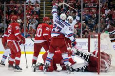 CrowdCam Hot Shot: New York Rangers defenseman Ryan McDonagh celebrates left wing Benoit Pouliot goal during the second period against the Detroit Red Wings at Joe Louis Arena. Photo by Tim Fuller
