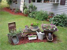 My wheelbarrow and antique display this year garden junk, garden yard ideas, garden projects Garden Yard Ideas, Rustic Gardens, Patio Garden, Rustic Garden Decor, Outdoor Garden Statues, Country Gardening, Garden Junk, Garden Decor, Vintage Garden Decor