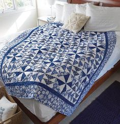 Pinwheel and Wild Goose Chase quilt blocks combine to make a lively new design in Mom Loved Blue, by Tony Jacobson. This two-color quilt is lovely as is, but would be perfect in any color you like. Make this throw-quilt pattern to coordinate with the colors in your home!